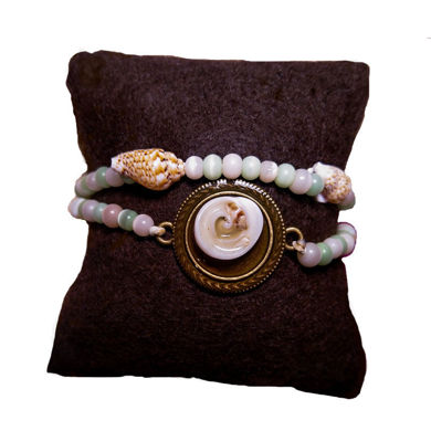 تصویر از دستبند صدف طبیعی چشم گربه ای، مدل O1، گروه دست سازه های طلایی